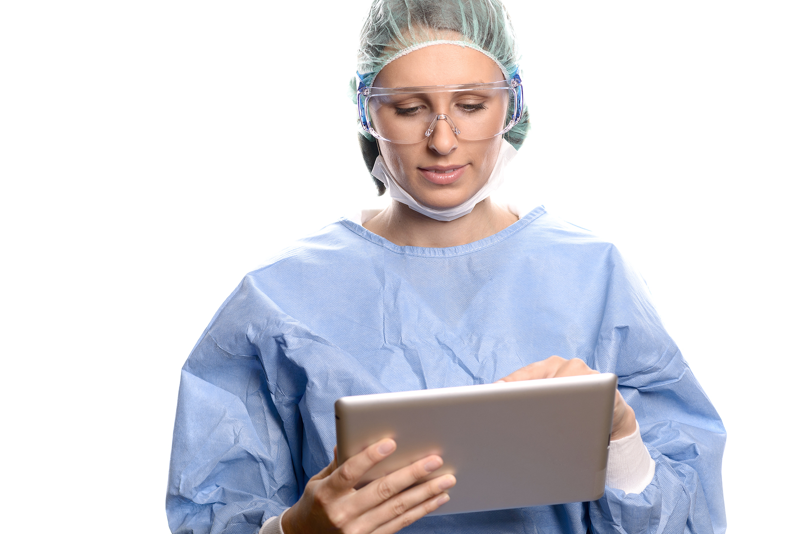 Doctor In Scrubs Entering Data On A Tablet
